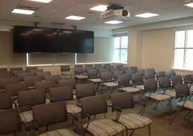 Classroom that provides ample seats and AV projection equipment.