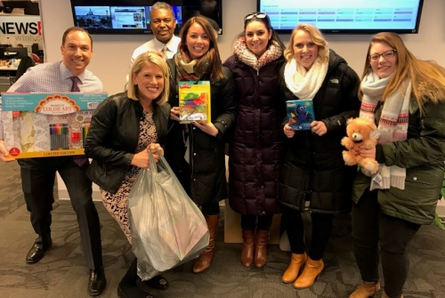 YC&E donates to the GR8 Holiday Give!